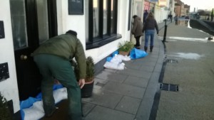 As the waters rose through the manholes extra sandbags are brought out in front of the Fountain pub.