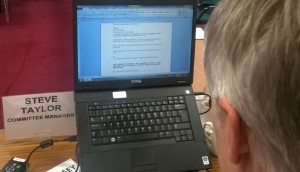 Committee clerk Steve Taylor endeavours to keep up with the rapidly changing motion...