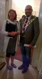 New Mayor of Bridgwater Leigh Redman (in jeans and chains) opens the Town Annual meeting by welcoming deputy council leader Kathy Pearce (Westover)