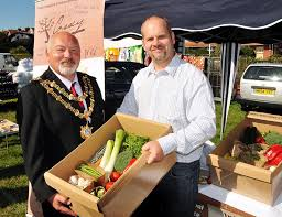The value of a Mayor is no longer measured by his weight in comparison to a box of vegetables.